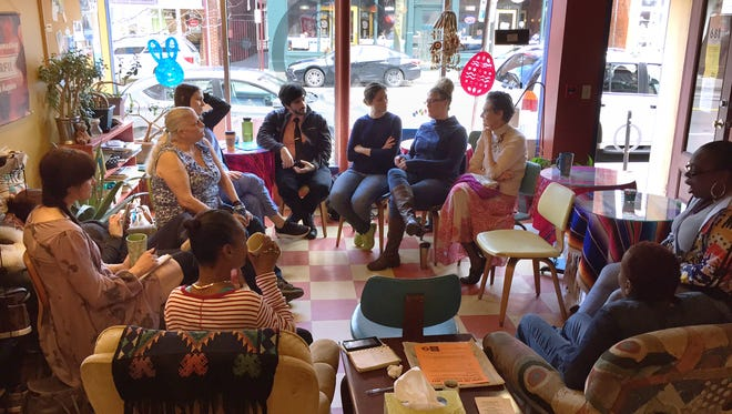 Patrons of the Coffee Connection, on South Avenue, talk about pay equity . The shop charged men more for a cup of coffee on April 4, 2017, to raise awareness of Equal Pay Day.