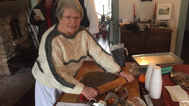 Becky Shemenski rolls out gingerbread dough.