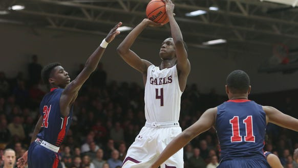 Iona's Souleymane Koureissi (4) puts up a shot in front