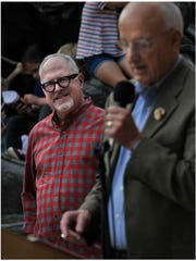 "Author William Joyce listens to former Abilene Mayor Gary McCaleb speak in October 2017 about the first time he read Joyce's book, ""Santa Calls,"" which features the Key City. McCaleb was a key proponent of starting the downtown sculpture effort more than 20 years."