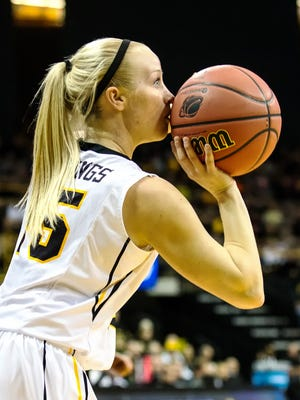 Iowa's Whitney Jennings (15) aims a 3-point shot against American during the first half of play Friday at Carver-Hawkeye Arena. Jennings scored 16 points in her first NCAA Tournament game.