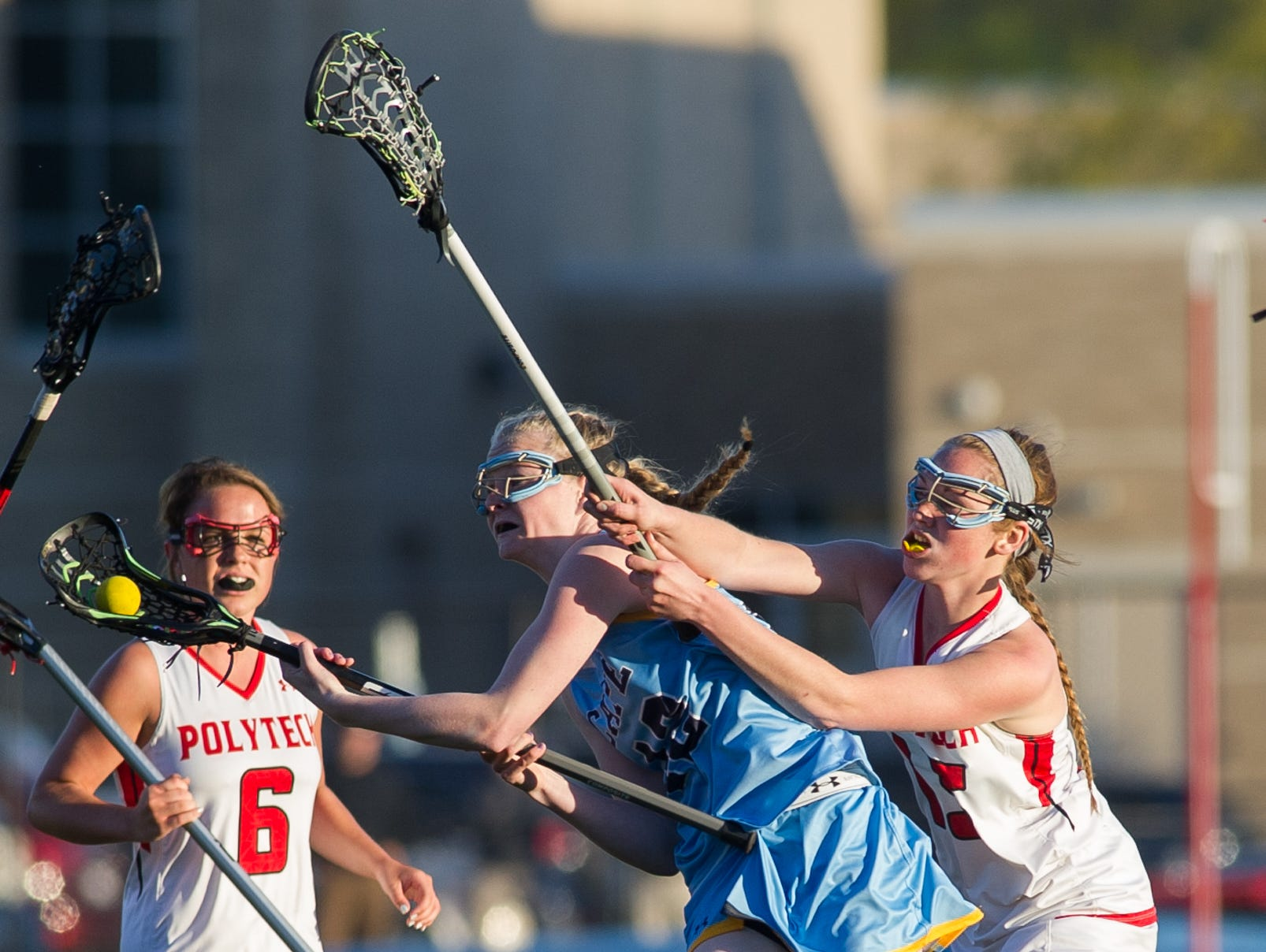 Cape Henlopen's Victoria Lockwood (12) tries to get a shot off in their win over Polytech.