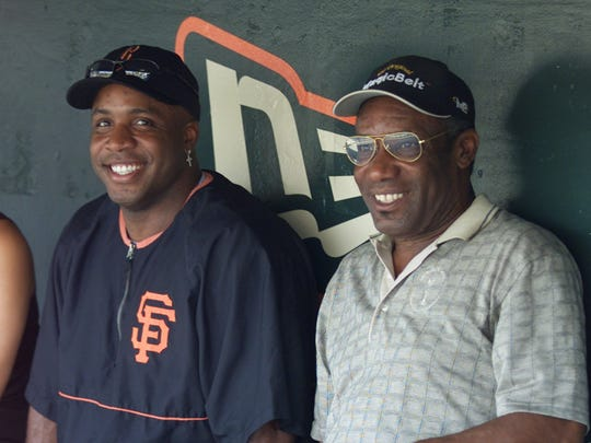 San Francisco Giants' Barry Bonds, left, sits with his father, Bobby Bonds, right, in the Giants' dugout prior to their game against the Pittsburgh Pirates in San Francisco, Friday, Aug. 9, 2002.