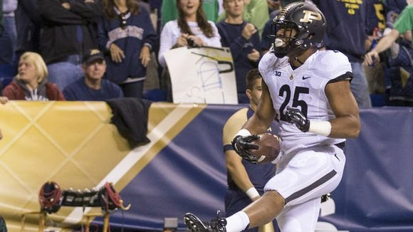Brandon Cottom, running back for Purdue, scores on this scramble in the first quarter, Purdue and Notre Dame football at Lucas Oil Stadium, Indianapolis, Saturday, September 14, 2014.