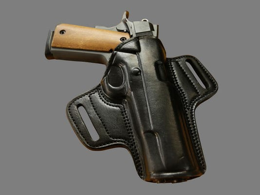 635803577386175775-holstered-handgun