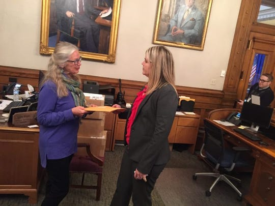 Leslie Bishop, a scientist who works with the Indiana Forest Alliance, delivers a letter to Gov. Eric Holcomb's office. This letter, signed by 228 Indiana scientists, is urging Holcomb to stay a timber sale of the Yellowwood Backcountry Area in the Morgan-Monroe State Forest that is scheduled for this week.