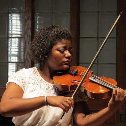 Violist Kayla Williams studied under music director