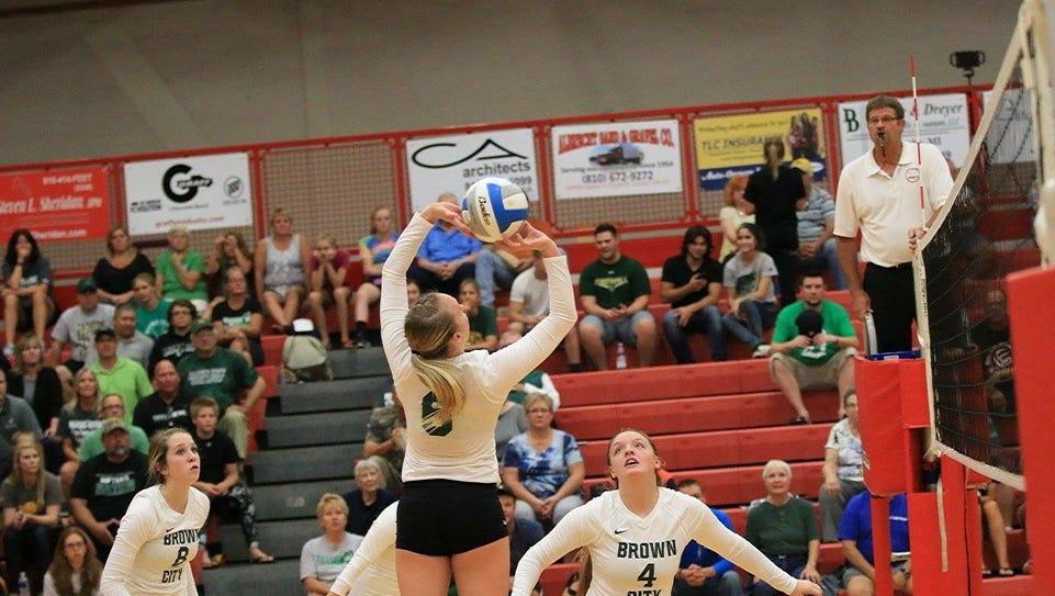 Alexia Mason sets the ball for a teammate during a