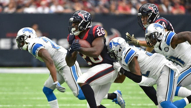 Houston Texans running back Lamar Miller (26) runs against the Detroit Lions during the second half of their game on Sunday in Houston.