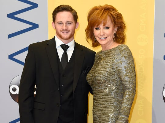 Shelby Blackstock and Reba McEntire arrive on the red
