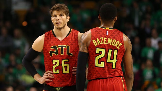 Kyle Korver and Kent Bazemore look on against the Boston Celtics during the second half in game six of the first round of the NBA Playoffs at TD Garden.