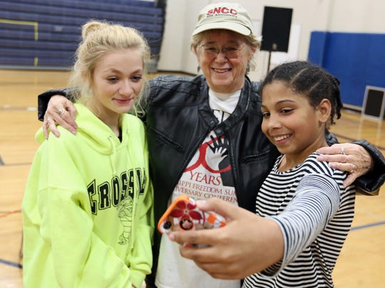 Shelby Powell, left, and Kalaeah Collins pose for a picture with Karen Trusty, a civil rights activist, after her presentation at Crossler Middle School students Monday, Jan. 11, 2016, in South Salem, Ore.
