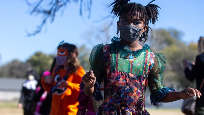 Sharnel Steward, a third-grader at State Street Elementary School, dressed as a zombie princess for Friday's Halloween parade.