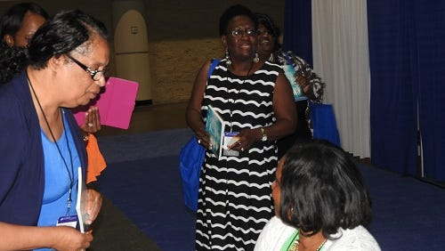 Minister Aaronetta and CVT members talking to young lady on Hope Universe Day