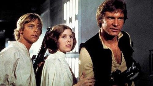 """Mark Hamill. Carrie Fisher and Harrison Ford in """"Star Wars,"""" which opened on May 25, 1977."""