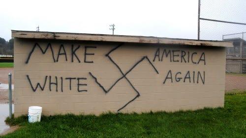 Graffiti of swastika on a softball field dugout in Wellsville, N.Y., Nov. 9, 2016.