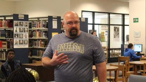 Chris Deal was introduced as Roberson's new football coach Monday morning.