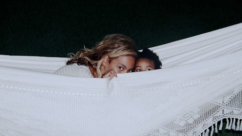 Beyonce and daughter Blue Ivy in a hammock.