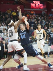 Shawnee's Dylan Deveney drives to the basket as Linden's