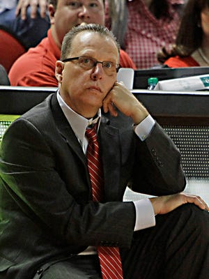 Western Kentucky coach Ray Harper watches as his team cannot catch No. 4 Louisville in their NCAA college basketball game in Bowling Green, Ky., Saturday, Dec. 20, 2014. Louisville held off Western Kentucky, 76-67. (AP Photo/Garry Jones)
