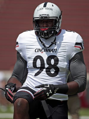 Bearcats defensive tackle Lyndon Johnson warms up during a practice at Nippert Stadium.