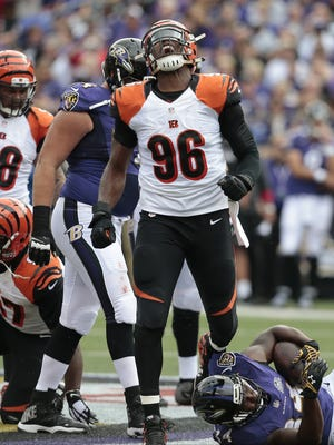 Carlos Dunlap celebrates a stop in the second quarter against the Ravens Sunday.