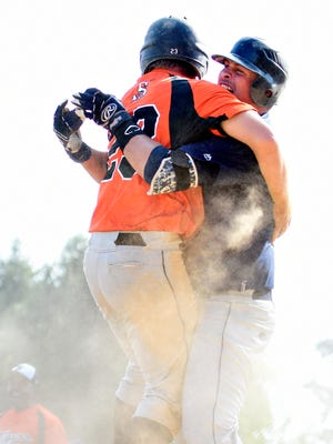 Stoverstown players celebrate a win over Burlington during Tom Kerrigan Memorial Baseball Tournament in Manchester on Labor Day, Monday, Sept. 5, 2016.  Stoverstown is the defending Kerrigan champion.