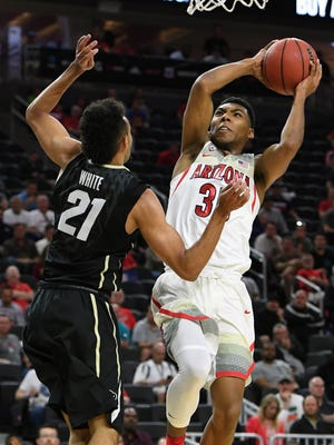 Allonzo Trier #35 of the Arizona Wildcats goes to the basket against Derrick White #21 of the Colorado Buffaloes during a quarterfinal game of the Pac-12 Basketball Tournament at T-Mobile Arena Arena on March 9, 2017 in Las Vegas, Nevada.