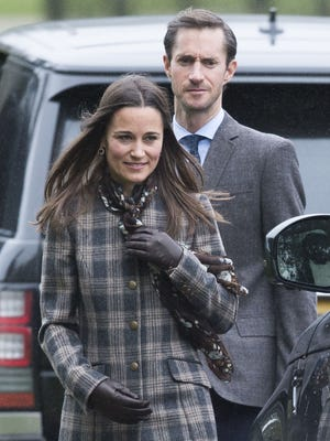 Pippa Middleton and James Matthews arrive at church on Dec. 25, 2016, in Bucklebury, near her parents' home. The couple will be married at the church on May 20.