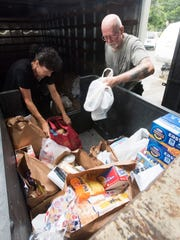 Manna Food Pantry volunteer Cindy Fox, left, and staffer