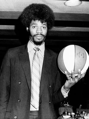 Artis Gilmore, 7-foot-2 player from Jacksonville University, is introduced to the press, on March 17, 1971, in New York, after he was signed by the Kentucky Colonels as their first round pick of the draft. On May 22, 1975, Gilmore scored 28 points and grabbed 31 rebounds to lead the Colonels to a 110-105 victory over the Indiana Pacers for the ABA championship.