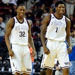 Jan 17, 2015; Starkville, MS, USA; Mississippi State Bulldogs guard Craig Sword (32) and guard Fred Thomas (1) celebrate after a basket during the game against the Vanderbilt Commodores at Humphrey Coliseum. Mississippi State Bulldogs defeat the Vanderbilt Commodores 57-54.  Mandatory Credit: Spruce Derden-USA TODAY Sports