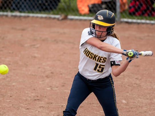 Port Huron Northern's Riley Shagena gets a hit during