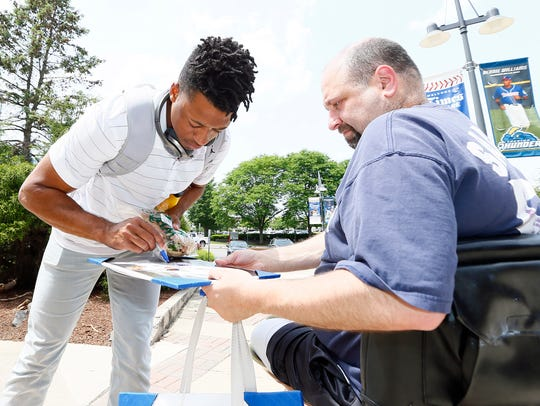 Trenton Thunder pitcher Dillon Tate signs an autograph