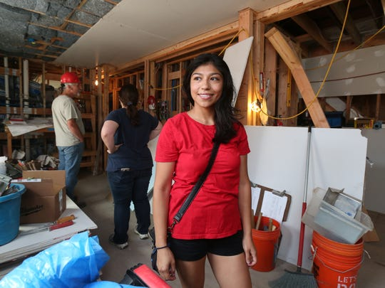 Silvia Rosales, who lives in a Habitat for Humanity property on Porach Street in Yonkers, is pictured at the Habitat for Humanity Westchester house under renovation on High Street in Yonkers.