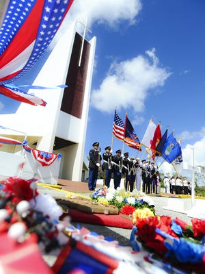 In this May 2013 file photo, members of the Joint Service Color Guard present the flags during the Memorial Day ceremony at the Guam Veterans Cemetery in Piti.