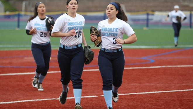 Christina Braid (3), Jaden Farhat (10) and Kayla Robert (25), of Immaculate Conception.
