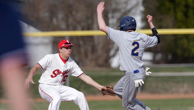 Sheboygan South's Lars Krugel (10) tags out Sheboygan North's Brent Widder, at Wildwood baseball park, Tuesday, May 1, 2018, in Sheboygan, Wis.