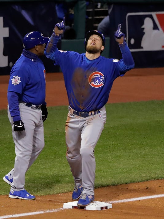 Chicago Cubs' Ben Zobrist reacts after his RBI triple during the fifth inning of Game 2 of the Major League Baseball World Series against the Cleveland Indians Wednesday, Oct. 26, 2016, in Cleveland. (AP Photo/Gene J. Puskar)