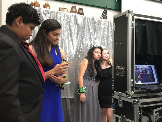 King High School students wait in line to take photos