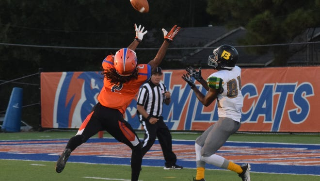 Louisiana College's Lecorey Demease (2, left) intercepts a pass intended for Belhaven University's (Jackson, Miss.) LaMiquell Roberts (81, right) in an NCAA division III game played at Wildcat Stadium on the Louisiana College campus in Pineville, La., Saturday, Oct. 22, 2016.