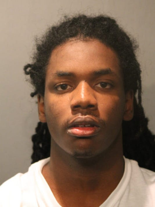 Maurice Harris, 19, was arrested on Tuesday and charged with four counts of  first-degree murder for a quadruple homicide at a Chicago fast food  restaurant.