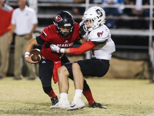 Ballinger's Jaedan Coy is tackled by Sonora's Brock