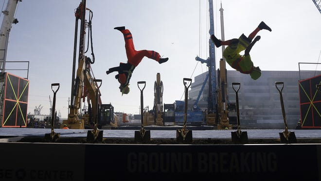 A group performs during a ground breaking ceremony for the Golden State Warriors' new arena, the Chase Center, in San Francisco.