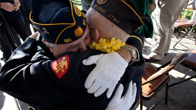 Pearl Harbor Survivors Association member and United States Navy veteran Dick Werner gets a hug from American Legion Post 90 Commander Bill Haynes, left, following a memorial service marking the 70th anniversary of the Japanese attack on Pearl Harbor at Vernon Worthen Park in St. George, Dec. 7, 2011.