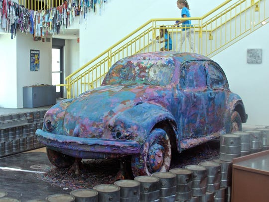 A vintage Volkswagen Beetle acts as a canvas for children to paint on, Monday, at the Children's Discovery Museum in Rancho Mirage.