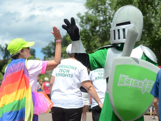 The Vermont Technical College knight gives high fives