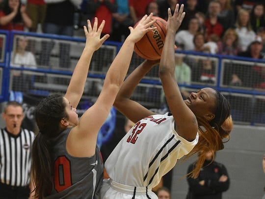 Westmoreland's Karley Smith blocks a shot from Pearl-Cohn's Kalaiah Coleman during Monday's Region 5-AA Tournament semifinals.