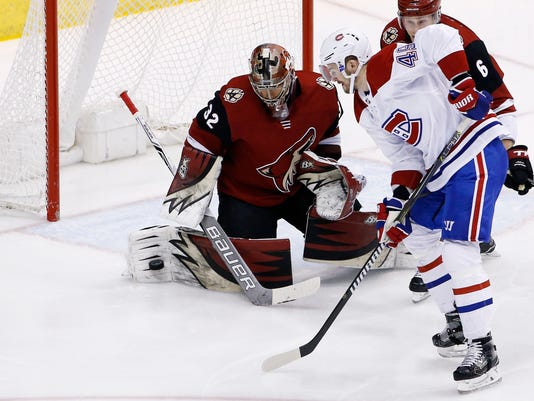 Montreal Canadiens right wing Logan Shaw (49) gets his shot blocked by Arizona Coyotes goaltender Antti Raanta (32) as Coyotes defenseman Jakob Chychrun (6) helps out during the first period of an NHL hockey game Thursday, Feb. 15, 2018, in Glendale, Ariz. (AP Photo/Ross D. Franklin)