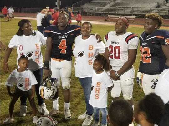 Blackman's Jordan Brown (4) and Treven Brown (92) pose with their cousin, Oakland's Cameron Snelling (20) after the two teams played during the regular season. The two squads battle at Oakland in the second round of the 6A playoffs Friday.